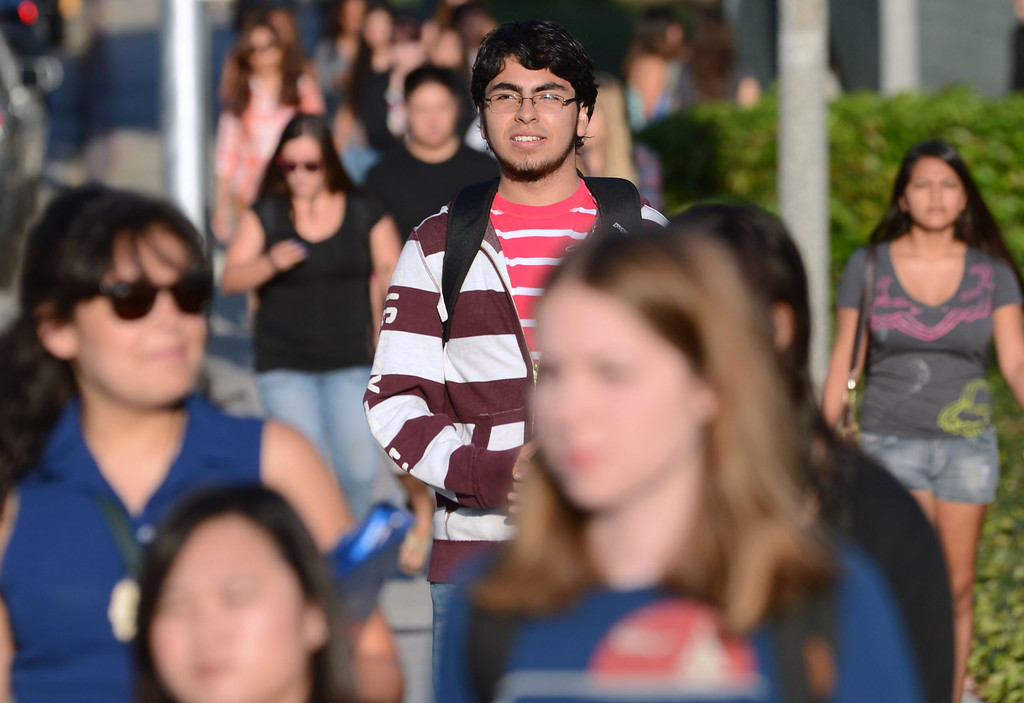 . Long Beach, Calif., -- 08-26-13- Carlos Vergara, a CSULB freshman and president�s scholar and aerospace engineering major heads off to his first class Monday morning. Monday is the start of classes for students at CSULB.        Stephen Carr/  Los Angeles Newspaper Group