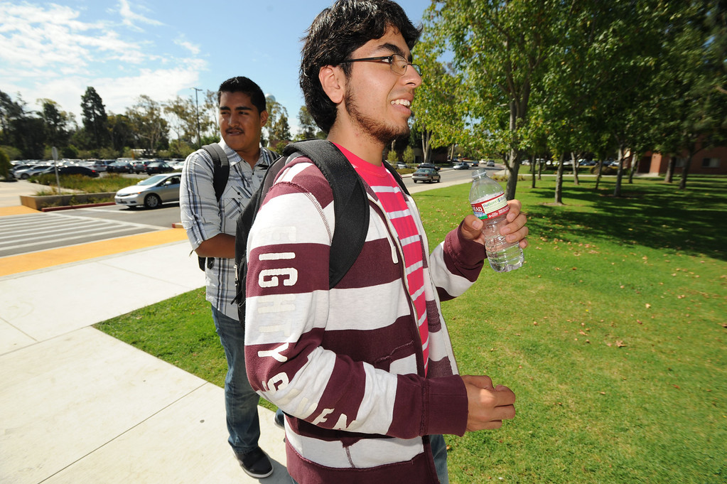 . Long Beach, Calif., -- 08-26-13- Carlos Vergara, a CSULB freshman and president�s scholar and aerospace engineering major, walks with friend and fellow CSULB freshman Miguel Gonzalez, Monday.  Monday is the start of classes for students at CSULB.        Stephen Carr/  Los Angeles Newspaper Group