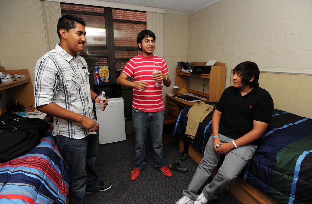 . Long Beach, Calif., -- 08-26-13- From left to right, CSULB freshman Miguel Gonzalez, visits the dorm room of Carlos Vergara, a CSULB freshman and president�s scholar and aerospace engineering major,  and Ramiro Insuasti. Monday.  CSULB started classes Monday.    Stephen Carr/  Los Angeles Newspaper Group