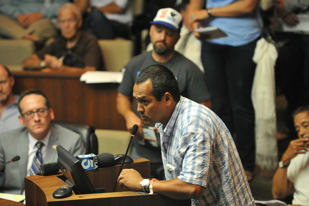 . Shark attack victim Steven Robles addresses the Manhattan Beach City Council during public comment about the possible ban on fishing off the pier after the recent shark attack, in Manhattan Beach, CA. on Tuesday July 15, 2014. (Photo by Sean Hiller/ Daily Breeze).