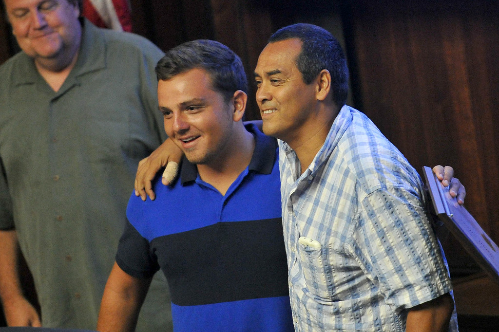 . Shark attack victim Steven Robles, right, get a hug from Ryan Silver, who helped save him from the water, before the Manhattan Beach City Council heard public comment about the possible ban on fishing off the pier after the recent shark attack, in Manhattan Beach, CA. on Tuesday July 15, 2014. (Photo by Sean Hiller/ Daily Breeze).
