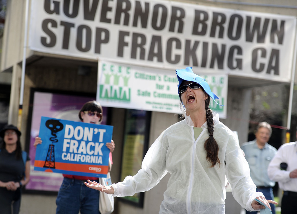 """. Andrea Weber, with the Center for Biological Diversity leads environmentalists a demonstration to protest \""""fracking\"""" outside the Coastal Commission\'s meeting at Long Beach City Hall in Long Beach, CA. on Wednesday March 12, 2014. (Photo by Sean Hiller/ Daily Breeze)."""