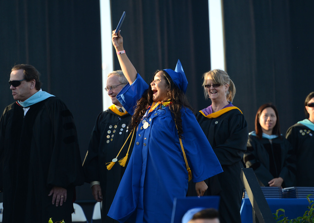 . Warren graduate Gabrielle Villa celebrates after receiving her diploma during the Warren High School Commencement Ceremony, at Cerritos College.  Norwalk Calif., Thursday June19,  2014.     (Photo by Stephen Carr / Daily Breeze)