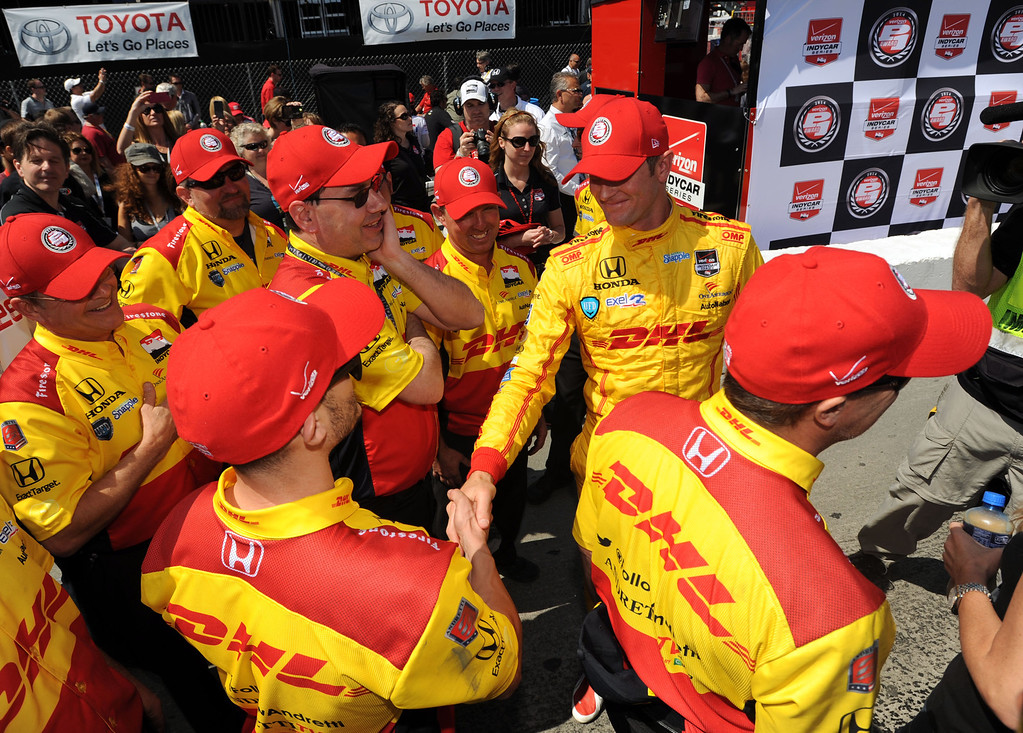 . IndyCar driver Ryan Hunter -Reay ,right, celebrates with his pit crew, after winning the IndyCar Qualifying & Firestone Fast 6 Saturday, at the 40th Annual Toyota Grand Prix of Long Beach.       Long Beach Calif., Saturday, April 12,  2014.   (Photo by Stephen Carr / Daily Breeze)