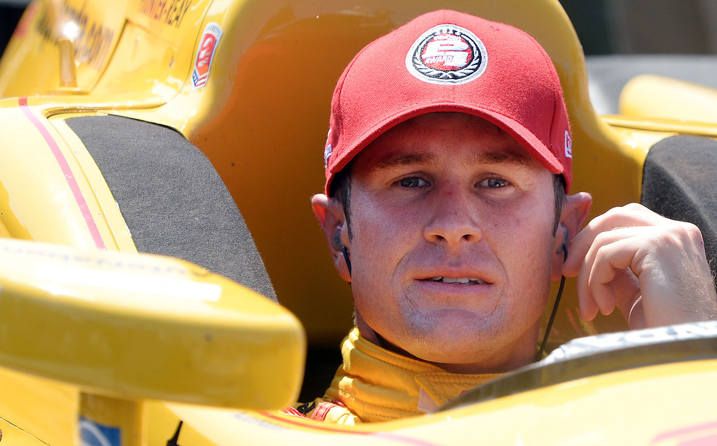 . Indycar driver Ryan Hunter-Reay sits in his race car after winning the pole Saturday April 12, 2014 for Sunday\'s 40th Toyota Grand Prix of Long Beach.  (Will Lester/Inland Valley Daily Bulletin)