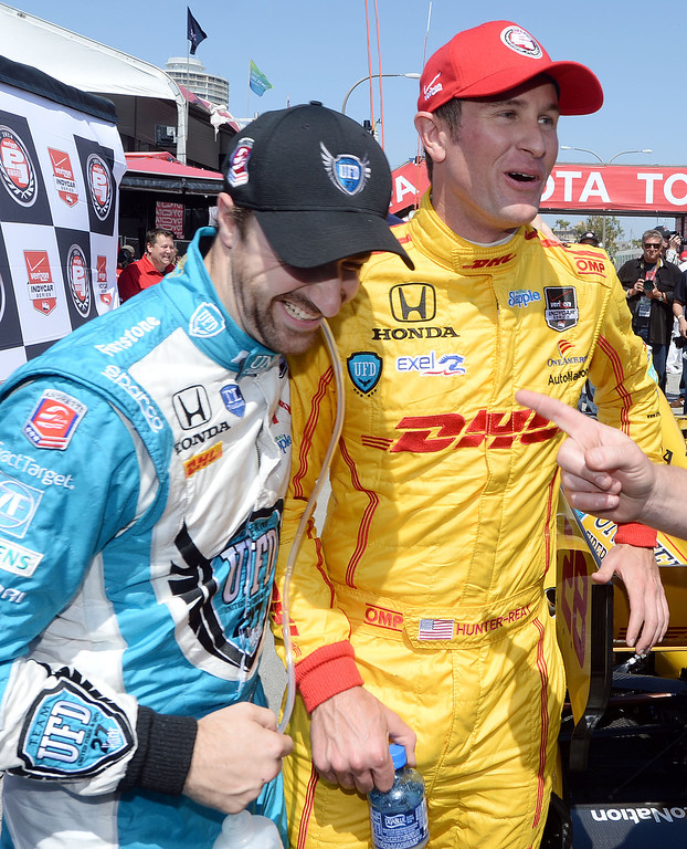 . Indycar pole winner Ryan Hunter-Reay (right) celebrates with second place qualifier James Hinchcliffe after wining the pole Saturday April 12, 2014 for Sunday\'s 40th Toyota Grand Prix of Long Beach.  (Will Lester/Inland Valley Daily Bulletin)