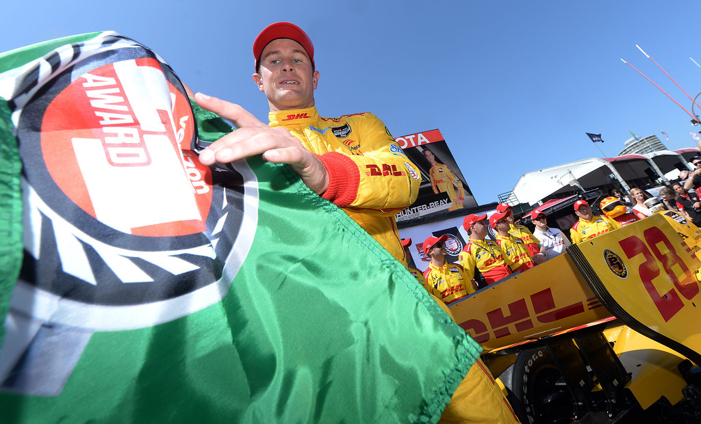 . Indycar pole winner Ryan Hunter-Reay is handed the pole winner award flag Saturday April 12, 2014 for Sunday\'s 40th Toyota Grand Prix of Long Beach.  (Will Lester/Inland Valley Daily Bulletin)