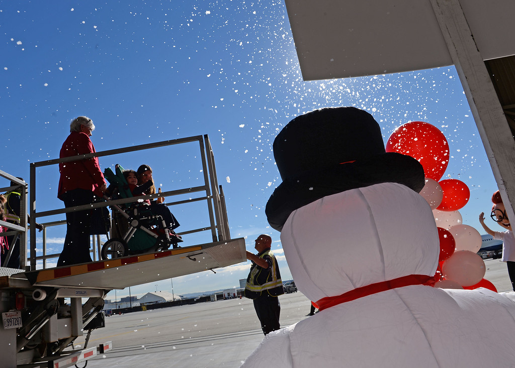 . Snow was flying as kids deplaned to the hanger set up as the North Pole. Holiday in the Hangar at Delta Airlines at LAX. About 100 children from Children\'s Hospital, LA got to ride on a plane to the North Pole where holiday games and fun plus Santa awaited. (Dec 11, 2013. Photo by Brad Graverson/The Daily Breeze)
