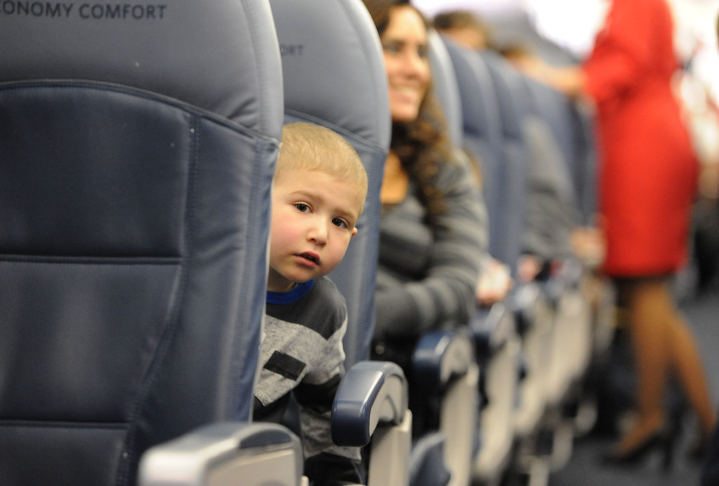 """. Alex Segil was on the lookout during the \""""flight\"""" at LAX. Holiday in the Hangar at Delta Airlines at LAX. About 100 children from Children\'s Hospital, LA got to ride on a plane to the North Pole where holiday games and fun plus Santa awaited. (Dec 11, 2013. Photo by Brad Graverson/The Daily Breeze)"""
