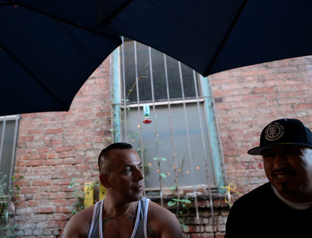 ". Sergio Romero, left, and Cisco Rios, right, talk about being gay gang members and about the documentary film ""Homeboy\"" which looks at gay gang members micro-culture within the gang culture in Los Angeles August 28, 2013. (Thomas R. Cordova/Staff Photographer)"