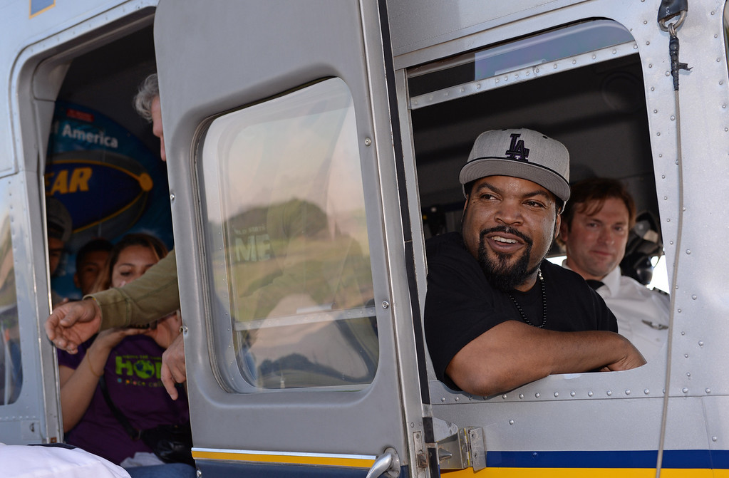 . Actor/rapper Ice Cube visited the Goodyear Airship Operations airfield in Carson Monday to add support to a charity effort for A Place Called Home, a local non-profit group that helps kids stay in school and prosper. A $25,000 check was presented to the group. Ice Cube\'s name was placed in lights on the blimp, recalling lyrics to one of his songs. Photo by Brad Graverson/The Daily Breeze 01/20/14