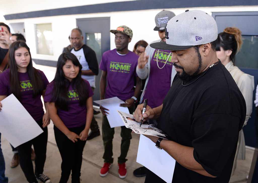 . Actor/rapper Ice Cube visited the Goodyear Airship Operations airfield in Carson Monday to add support to a charity effort for A Place Called Home, a local non-profit group that helps kids stay in school and prosper. He signs autographs for some of the kids. A $25,000 check was presented to the group. Ice Cube\'s name was placed in lights on the blimp, recalling lyrics to one of his songs. Photo by Brad Graverson/The Daily Breeze 01/20/14
