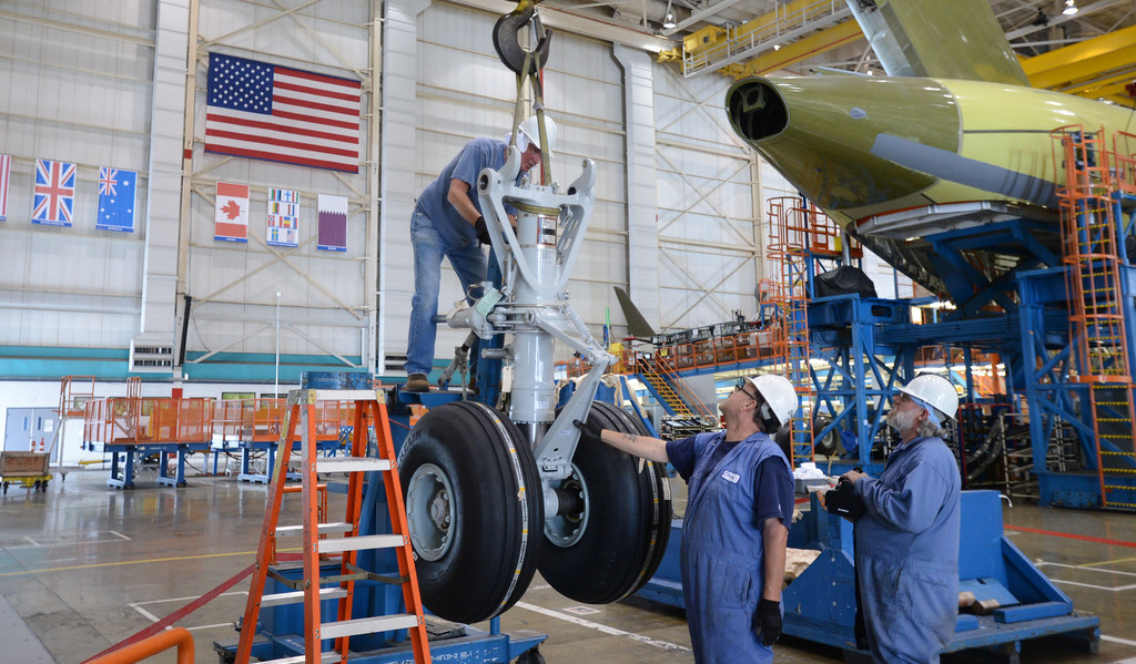 . Long Beach, Calif., -- 08-13-13-   Workers prepare to assemble landing gear for a Boeing C-17 Globemaster III ,  at the C-17 plant in Long Beach Calif.    Stephen Carr/  Los Angeles Newspaper Group
