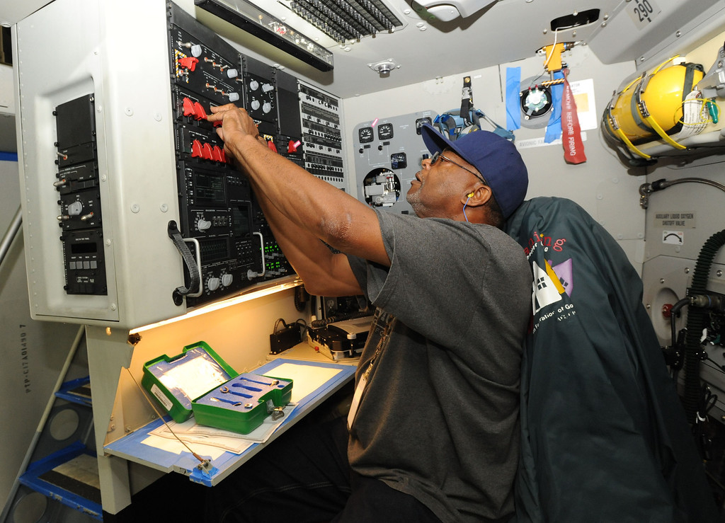 . Long Beach, Calif., -- 08-13-13-   Avionics systems technician Jay Gooden works on a new Boeing C-17 Globemaster III as it\'s assembled at the C-17 plant in Long Beach Calif. Gooden has worked for Boeing for 25 years.    Stephen Carr/  Los Angeles Newspaper Group