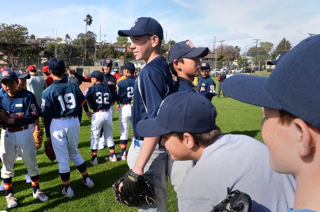 . Tommy Grant of El Segundo and Japanese little leaguer Shingo Tomita compare their heights as the players mingles before practice session. The visiting Japanese teams are playing in a tournament this weekend in El Segundo. Photo by Brad Graverson 3-27-14