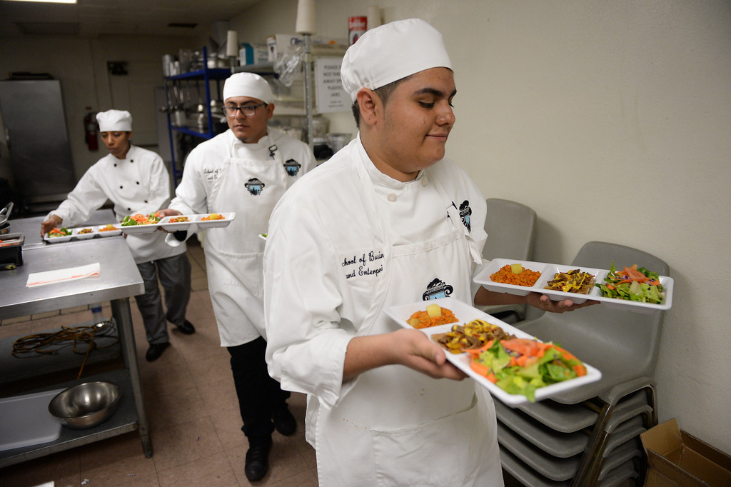 """. LAUSD \""""Cooking Up Change\"""" culinary competition for high school students held at LA TradeTechnical College. West Adams Prep chefs bring out their creations for judging.  (Thurs. Jan 30, 2014 Photo by Brad Graverson/The Daily Breeze)"""