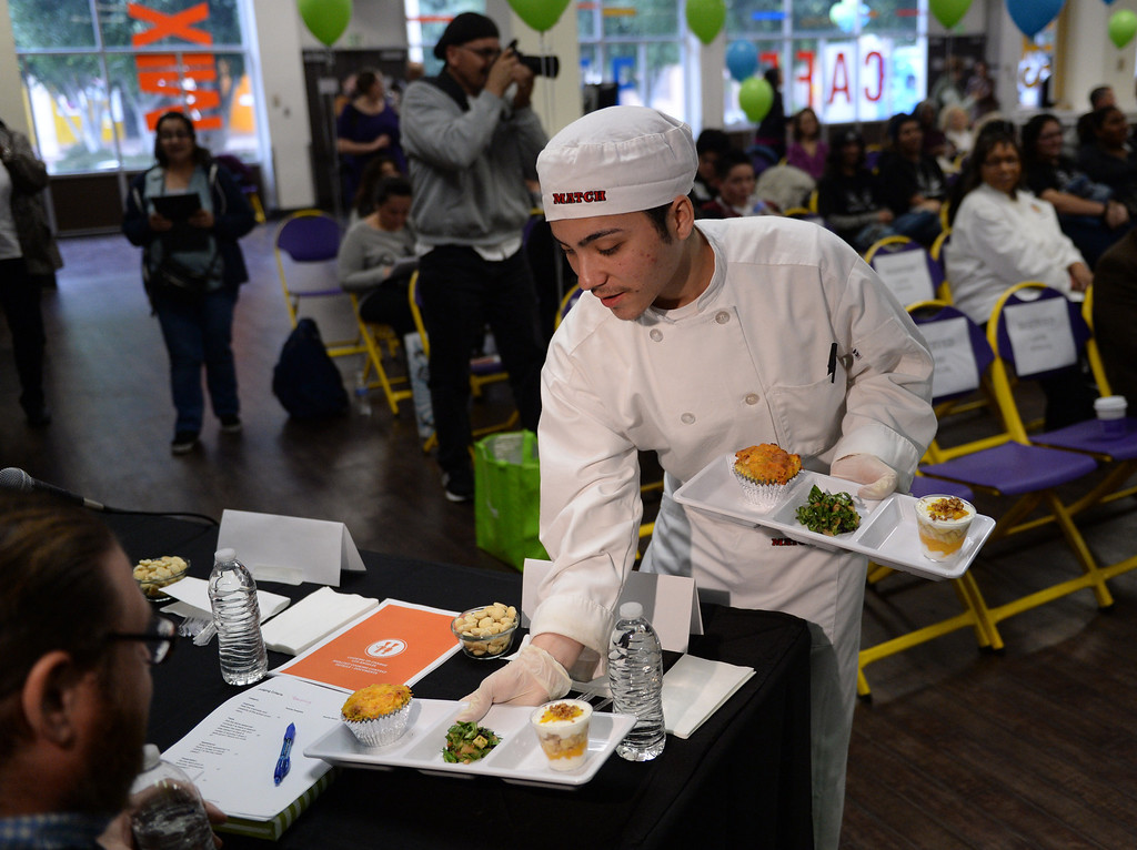 """. LAUSD \""""Cooking Up Change\"""" culinary competition for high school students held at LA TradeTechnical College. Banning High School chef Bryan Orozco presents his team\'s entry to the judges.  (Thurs. Jan 30, 2014 Photo by Brad Graverson/The Daily Breeze)"""