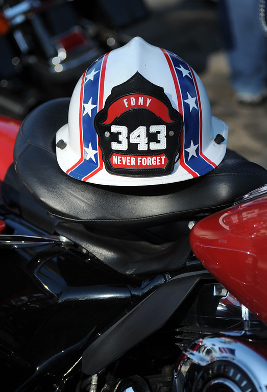 . Long Beach fire fighters rode their motorcycles from Cooks Corner in Orange County to Long Beach Wednesday in remembrance of 9-11. More than two hundred riders participated.  Gary Biggerstaff\'s fire-motorcycle helmet with the number 343 which represents the fire fighters killed in 9-11. Wednesday, September 11, 2013,  Long Beach, CA. Photo by Steve McCrank / Daily Breeze