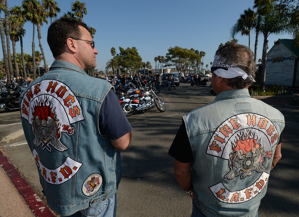 . Long Beach fire fighters rode their motorcycles from Cooks Corner in Orange County to Long Beach Wednesday in remembrance of 9-11. More than two hundred riders participated.  Peter Mannise, a former New York fire fighter, and Kevin Smith, an honorary fire fighter, attend the ride. Wednesday, September 11, 2013,  Long Beach, CA. Photo by Steve McCrank / Daily Breeze