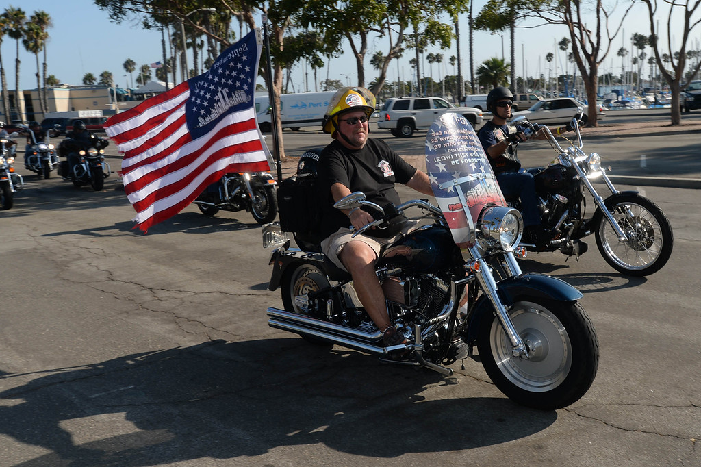 . Long Beach fire fighters rode their motorcycles from Cooks Corner in Orange County to Long Beach Wednesday in remembrance of 9-11. More than two hundred riders participated. Wednesday, September 11, 2013,  Long Beach, CA. Photo by Steve McCrank / Daily Breeze