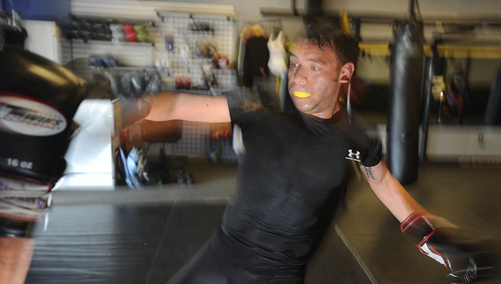 . Chris Pena trains at Antonio McKee\'s gym in Lakewood, CA on Thursday, September, 5, 2013. (Photo by Sean Hiller/ Press Telegram/ LANG)