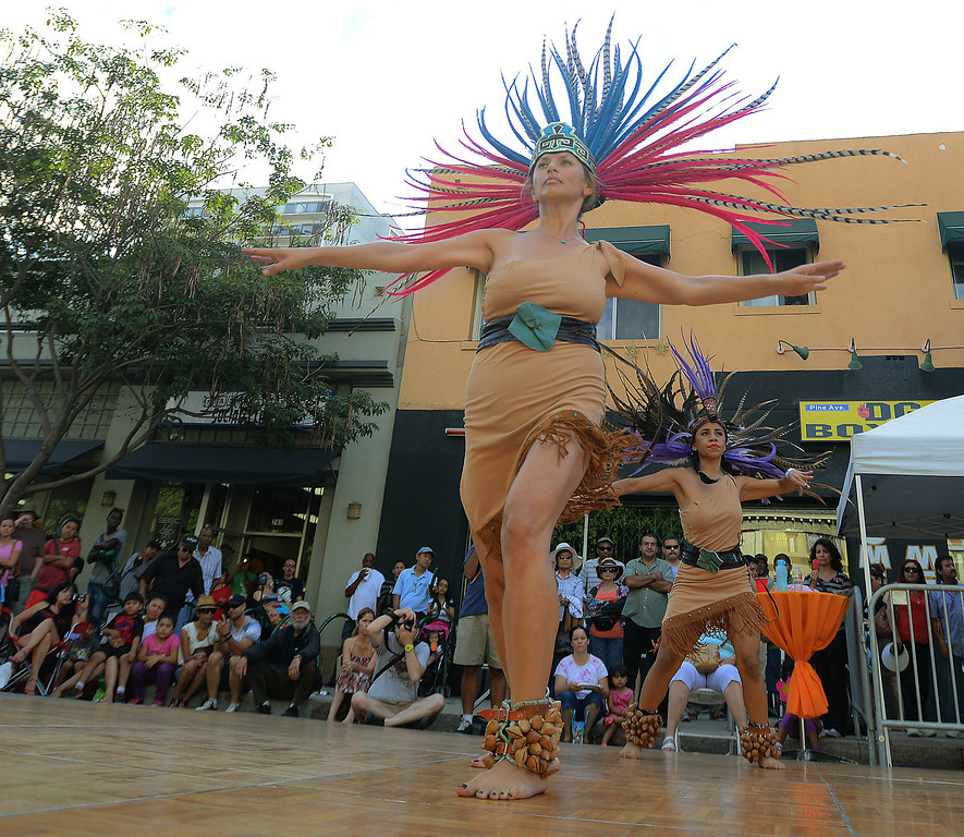 . Aida Landeros,front, and Nashua Mena  perform an Aztec dance to kick off the 5th Annual Latin American Festival on North Pine in Long Beach, CA. on September 7, 2013.(Photo by Sean Hiller/Press Telegram)