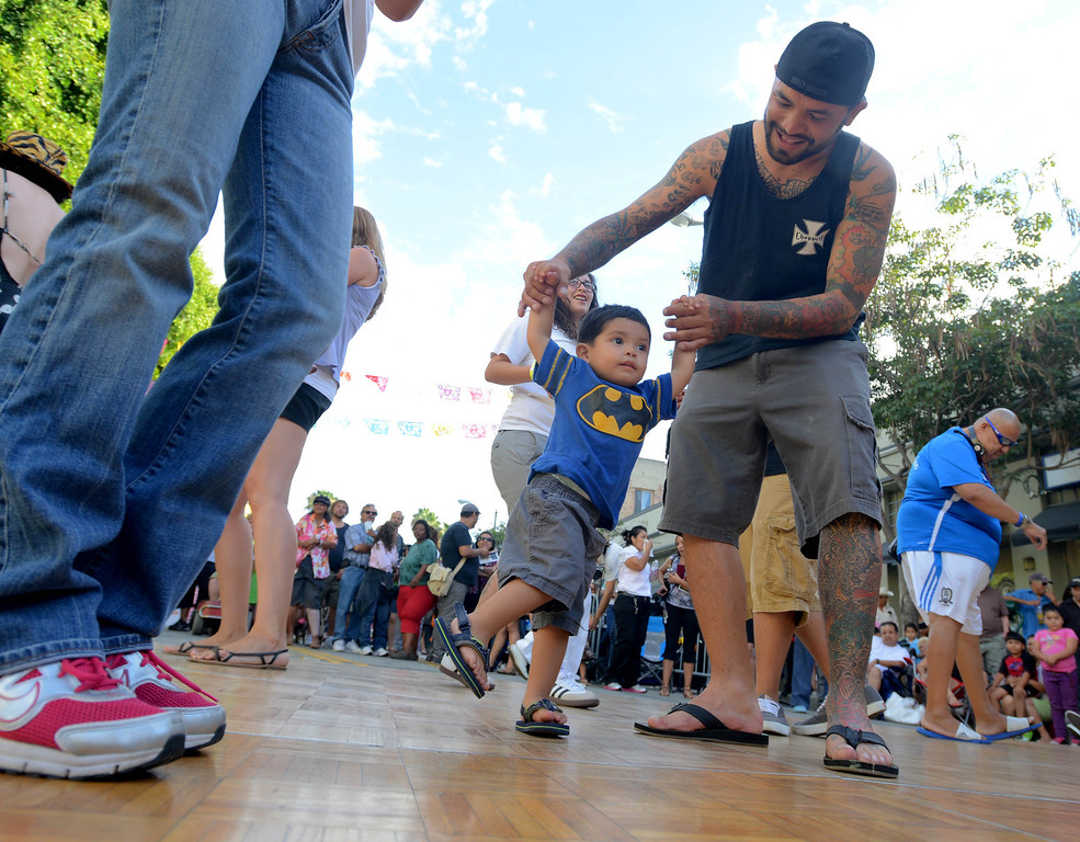 . Steve Jaramillo and son Adrian,20-months, enjoy the music at the 5th Annual Latin American Festival on North Pine in Long Beach, CA. on September 7, 2013.(Photo by Sean Hiller/Press Telegram)