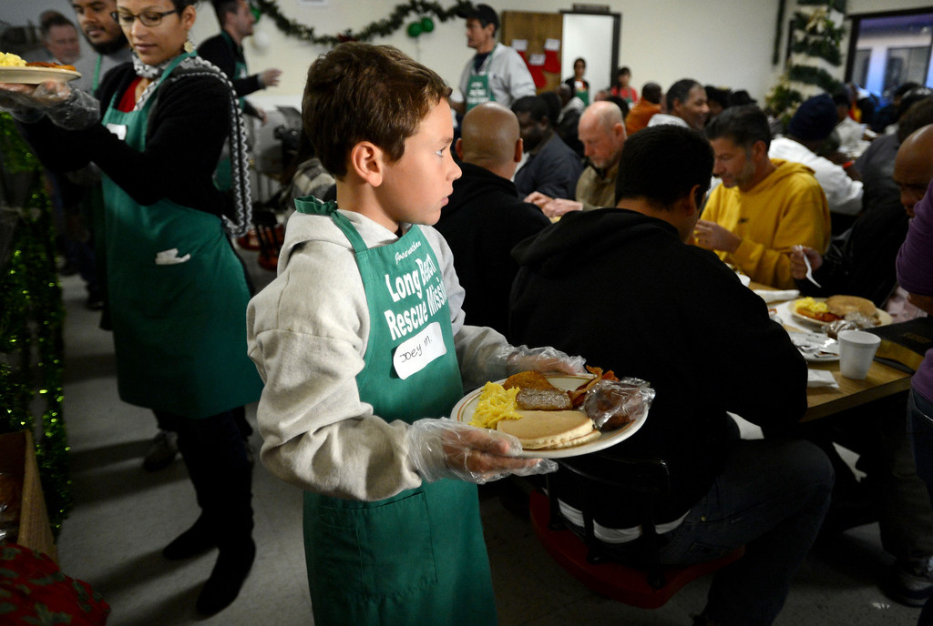 . Joseph McGrath,10,  helps serve meals during the Long Beach Rescue Mission Christmas Breakfast Tuesday morning. The breakfast was held from 7 AM to 10 AM. and between 500 and 600 meals were served.  Long Beach, Calif. Tuesday, December 24, 2013.   (Photo by Stephen Carr / Daily Breeze)