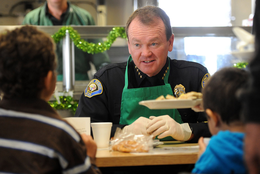 . Long Beach Police chief Jim McDonnell talks with brothers Christopher Steiner,9, left, and Michael Steiner, 4, during the Long Beach Rescue Mission Christmas Breakfast Tuesday morning. The breakfast was held from 7 AM to 10 AM. and between 500 and 600 meals were served.  Long Beach, Calif. Tuesday, December 24, 2013.   (Photo by Stephen Carr / Daily Breeze)