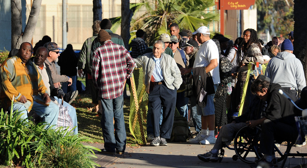. A large line outside the Long Beach Rescue Mission, as the mission hosted a Christmas Breakfast Tuesday morning from 7 AM to 10 AM.  Between 500 and 600 meals were served.  Long Beach, Calif. Tuesday, December 24, 2013.   (Photo by Stephen Carr / Daily Breeze)