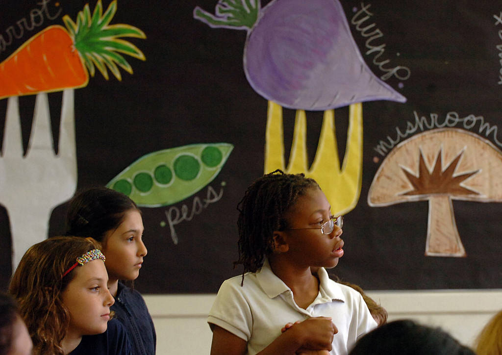 . 0918-NWS-LPT-L-GREEN-01-TRC Alex Woodward, 9 right, Rebekah Castro, 9 center and Riley Guenther-Clark, 8 left, stand in their schools cafeteria at  Longfellow Elementary School, as U.S. Dept. of Education and state officials visit the Long Beach school because they\'ve won green ribbon awards for their environmental sustainability efforts in Long Beach CA. Tuesday September 18, 2013.  (Photo by Thomas R. Cordova/ Daily Breeze)