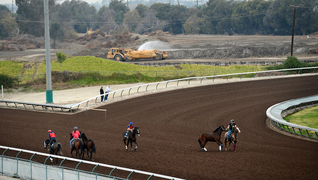 . Construction crews expand the Los Alamitos Race Course as quarter horses training during a morning session.  The race course will add thoroughbred racing next year to compensate for loss of the closed Hollywood Park Racetrack.   Los Alamitos, Calif. Wednesday December 18, 2013.   (Photo by Stephen Carr / Daily Breeze)