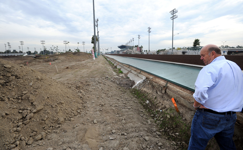 . Race track consultant Brad McKinzie at the spot where construction crews will expand the turn into the final stretch, at the Los Alamitos Race Course. The course will add thoroughbred racing next year, to compensate for loss of the closed Hollywood Park Racetrack.   Los Alamitos, Calif. Wednesday December 18, 2013.   (Photo by Stephen Carr / Daily Breeze)