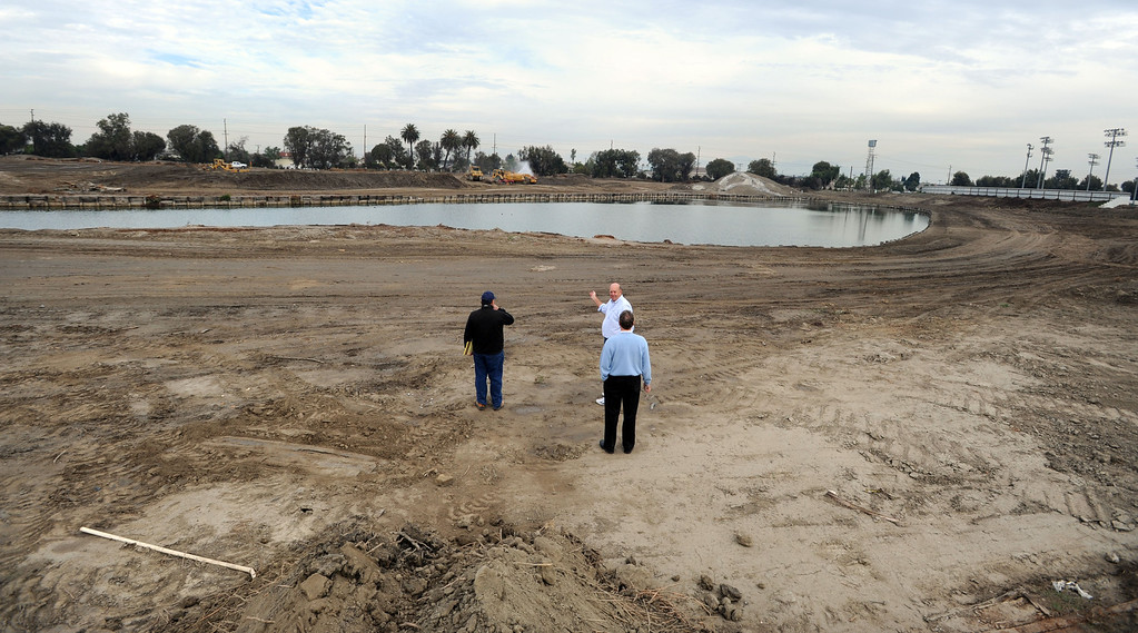 . Construction crews expand the Los Alamitos Race Course and will add thoroughbred racing next year,  to compensate for loss of the closed Hollywood Park Racetrack.   Los Alamitos, Calif. Wednesday December 18, 2013.   (Photo by Stephen Carr / Daily Breeze)
