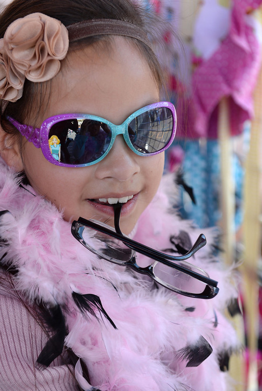 . Aisha Sosa liked the dress-up fashions. Mattel Corp. brought lots of snow and fun games to Washington Elementary in Hawthorne for its 12 Days of Play event.  (Dec 12, 2013. Photo by Brad Graverson/The Daily Breeze)