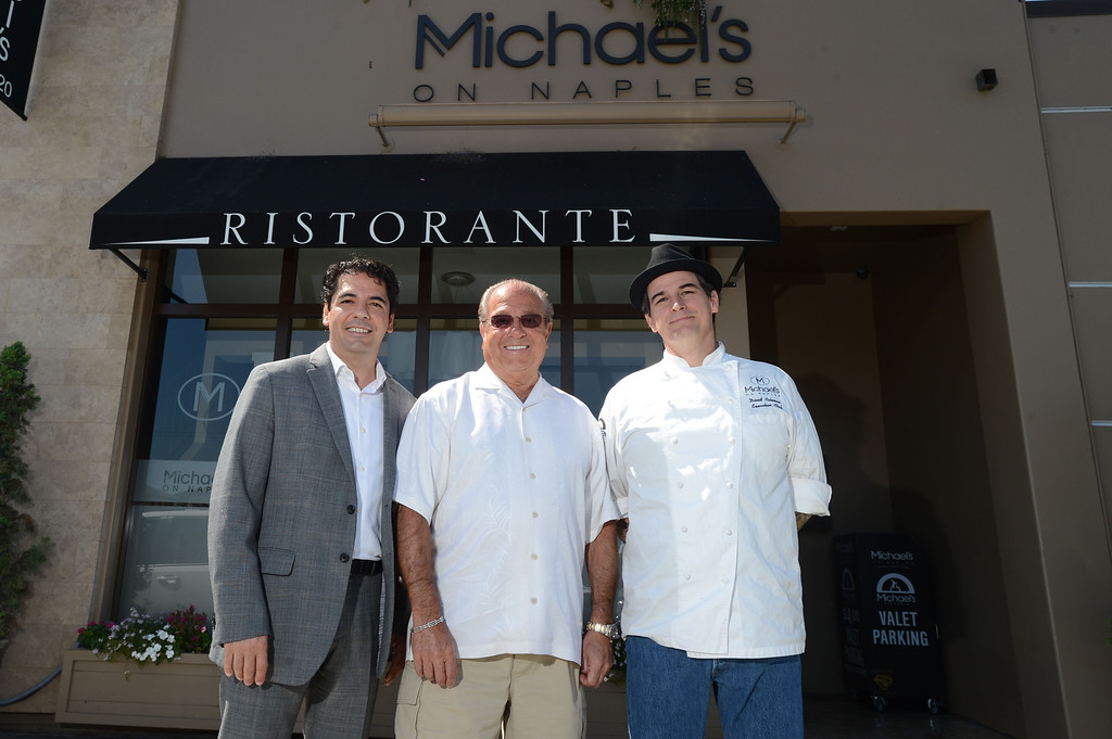 """. Long Beach, Calif., -- 08-29-13-  From left to right General manager Massimo Aronne, Long Beach restaurateur Michael Dene, owner of Michael\'s of Naples Restoranate and Michael\'s Pizzeria, Executive Chef David Coleman, plan to open an Italian steakhouse called \"""" Chianina, \"""" at the old Kelly\'s of Naples location, 5716 E 2nd St. They hope to open in December.    Stephen Carr/  Los Angeles Newspaper Group"""