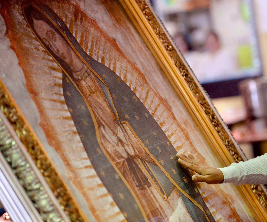 . Inmates pray in the presence of Our Lady of Guadalupe\'s portrait at morning Mass for incarcerated women at the Los Angeles County Century Regional Detention Facility in Lynwood on Sunday, Nov. 17, 2013. (Photo by Sean Hiller/Long Beach Press Telegram)