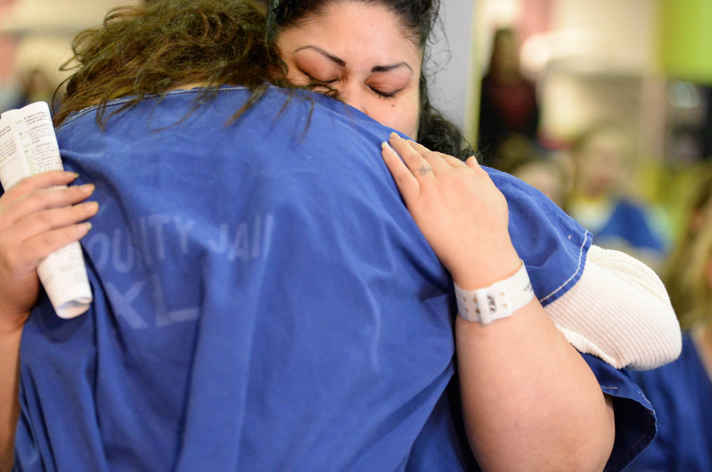 . Inmate Francisca Cabral, right, serving time for a narcotic-related charge, hugs a friend at Sunday Mass for incarcerated women at the Los Angeles County Century Regional Detention Facility in Lynwood on Sunday, Nov. 17, 2013. (Photo by Sean Hiller/Long Beach Press Telegram)
