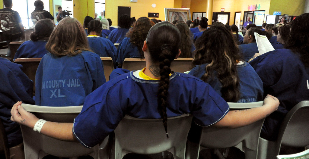. Inmates sit in the presence of Our Lady of Guadalupe\'s portrait at morning Mass for incarcerated women at the Los Angeles County Century Regional Detention Facility in Lynwood on Sunday, Nov. 17, 2013. (Photo by Sean Hiller/Long Beach Press Telegram)