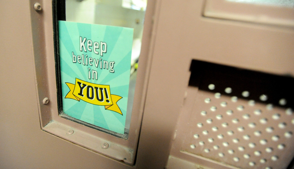 . A card in a cell window offers a message for inmates attending morning Mass for incarcerated women at the Los Angeles County Century Regional Detention Facility in Lynwood on Sunday, Nov. 17, 2013. (Photo by Sean Hiller/Long Beach Press Telegram)