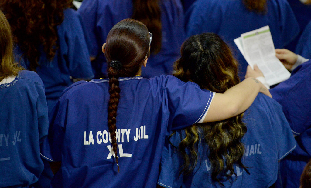 . Inmates get emotional in the presence of Our Lady of Guadalupe\'s portrait at morning Mass for incarcerated women at the Los Angeles County Century Regional Detention Facility in Lynwood on Sunday, Nov. 17, 2013. (Photo by Sean Hiller/Long Beach Press Telegram)