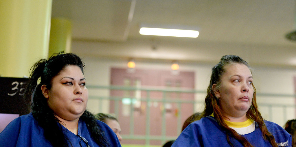 . Inmate Francisca Cabral, left, and Angela Zepeda, both serving time for a narcotic-related charge, pray in the presence of the portrait of Our Lady of Guadalupe at Sunday Mass for incarcerated women at the Los Angeles County Century Regional Detention Facility in Lynwood on Sunday, Nov. 17, 2013. (Photo by Sean Hiller/Long Beach Press Telegram)