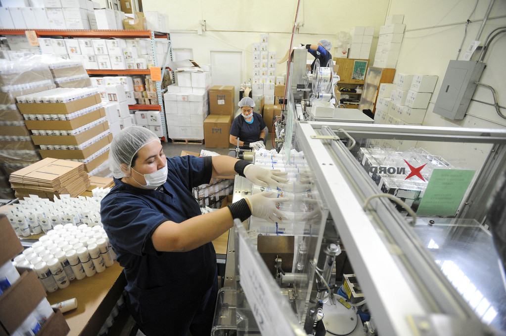 . Carla Medina works the assembly line at Valley of the Sun Cosmetics LLC, based in Gardena, which is among the small businesses and local Mom and Pop cosmetic outfits that are trying their hand at exporting their goods from their factory in Gardena, CA. on Thursday, November 6, 2013. (Photo by Sean Hiller/Press Telegram).