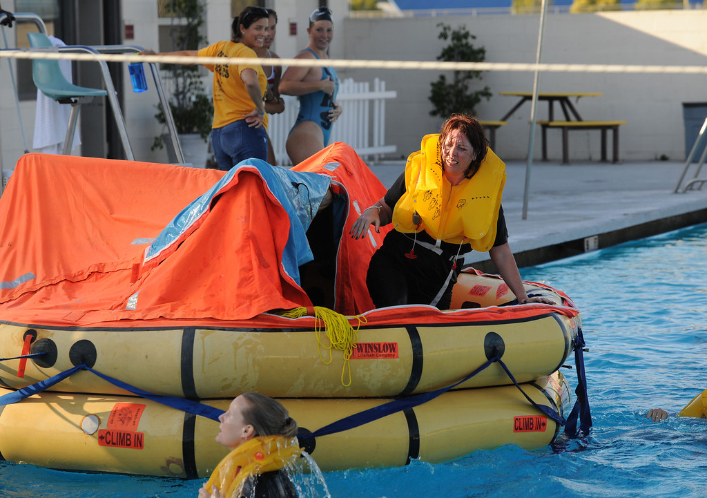 . Long Beach, Calif., -- 09-26-13- Aircare student Charlene O\'Neill  prepares to jump from an emergency raft, during training at the LBSU pool.   Aircare Solutions Group is comprised of business aviation products and services that combined, provide crew member emergency procedures training, tele-medical assistance, and crew staffing to flight departments worldwide.    Stephen Carr/  Daily Breeze