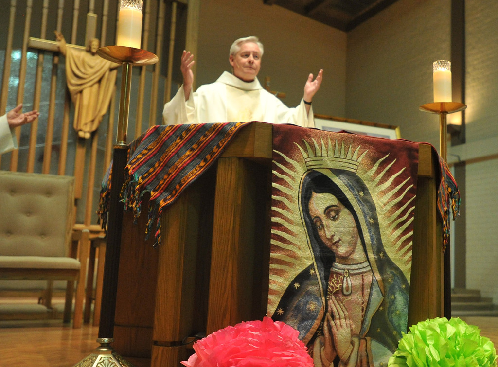 . Rev. Jim Halley leads the Mass to celebrate the feast day of Our Lady of Guadalupe at St. Joseph Catholic Church in Long Beach on Wednesday, Dec. 11, 2013. (Photo by Sean Hiller/Torrance Daily Breeze)