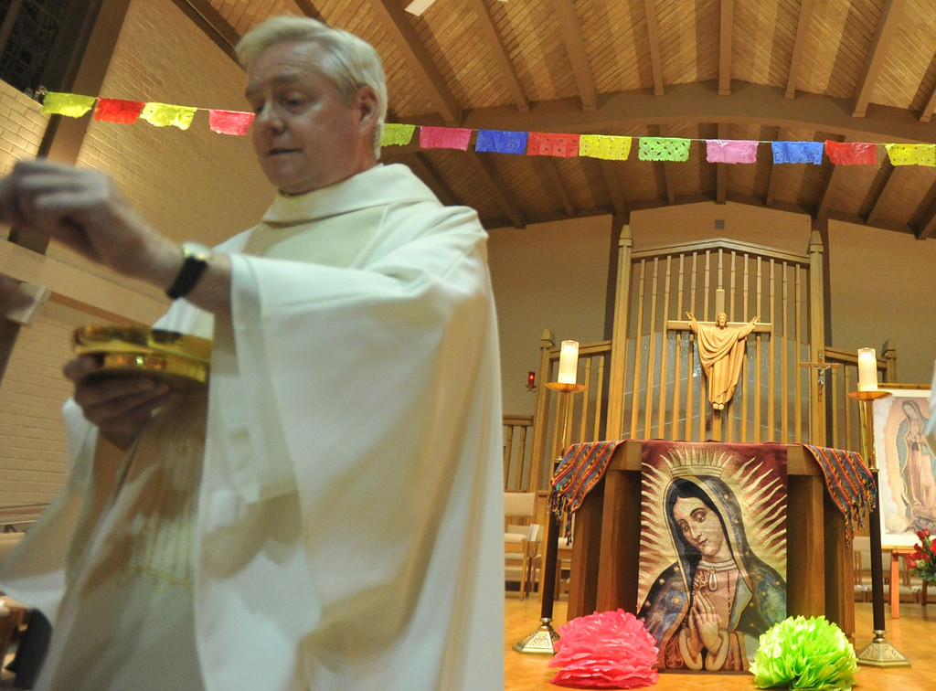 . Rev. Jim Halley leads the Mass to celebrate the birthday of Our Lady of Guadalupe at St. Joseph Catholic Church in Long Beach on Wednesday, Dec. 11, 2013. (Photo by Sean Hiller/Torrance Daily Breeze)