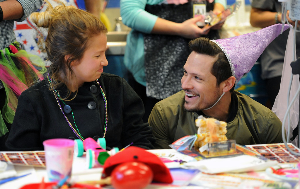 . Gabby Seaton ,13, of Long Beach,left, and  Toyota Grand Prix of Long Beach Pro/Celebrity Race participant and actor Nick Wechsler share a moment during a visit at the children at Miller Children�s Hospital at Long Beach Memorial Medical Center.       Long Beach Calif., Thursday, April 10,  2014.   (Photo by Stephen Carr / Daily Breeze)