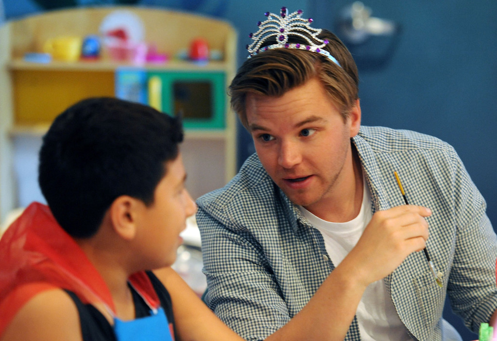 . Toyota Grand Prix of Long Beach Pro/Celebrity Race participant actor Brett Davern, with Victor Aguirre,13, of Long Beach,  as he and other participants met some of the children at Miller Children�s Hospital at Long Beach Memorial Medical Center,  who will benefit from the proceeds generated by the 38th annual Toyota Grand Prix of Long Beach Pro/Celebrity Race.     Long Beach Calif., Thursday, April 10,  2014.   (Photo by Stephen Carr / Daily Breeze)