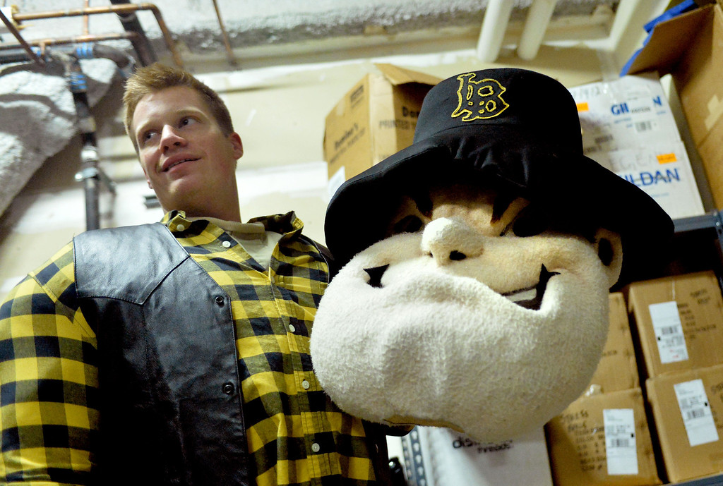 . Connor King, who is the man under the Prospector Pete mascot costume, gets ready for a Long Beach State men\'s basketball game at Walter Pyramid in Long Beach, CA. on Thursday, January 9, 2014. (Photo by Sean Hiller/ Daily Breeze).