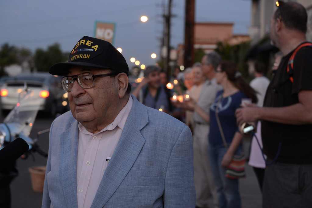 . A group holds a candle light vigil to protest proposed bombing of Syria in Long Beach Monday September 9, 2013. (Photo by Thomas R. Cordova/ Daily Breeze)
